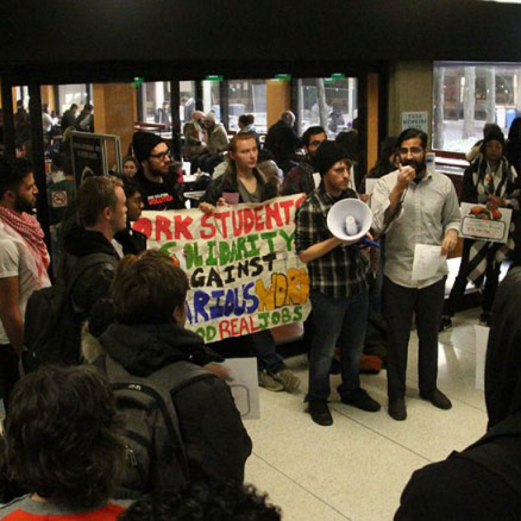 Activists organize rally to protest against alleged intimidation of cafeteria workers at York
